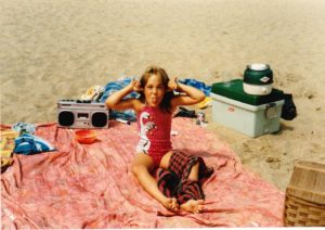 Jenny at the beach as a child